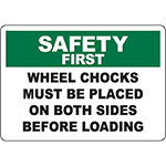 SAFETY FIRST Wheel Chocks Placed Before Loading Sign