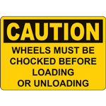 CAUTION WHEELS MUST BE CHOCKED BEFORE LOADING OR UNLOADING SIGN