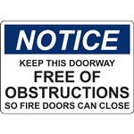 NOTICE KEEP THIS DOORWAY FREE OF OBSTRUCTIONS SO FIRE DOORS CAN CLOSE SIGN
