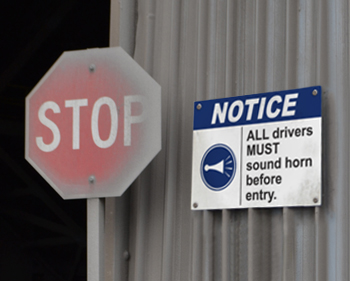 Notice sign instructs drivers.