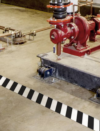 Floor makring alerts workers to an ammonia system.