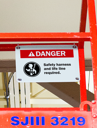Danger sign remind workers to wear PPE