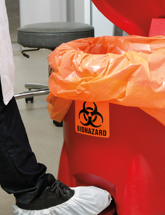 red biohazard waste bag and container