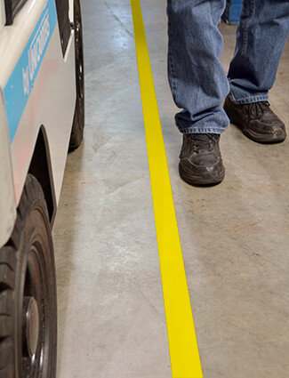 Floor marking guides forklifts for safety.