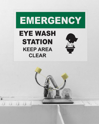 Signs alert to washing station safety rules.