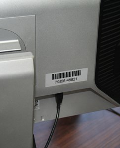 computer monitor with an asset barcode label